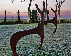 Contemporary Deer sculptures for the garden crafted from rusted metal by Garden Art and Sculpture. With its curvaceous lines the Deer Sculpture makes a stunning garden sculpture