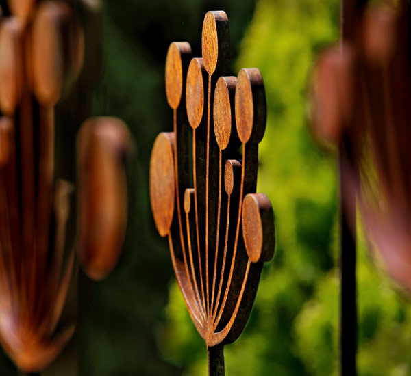Rusted metal garden sculpture inspired by the Cow Parsley