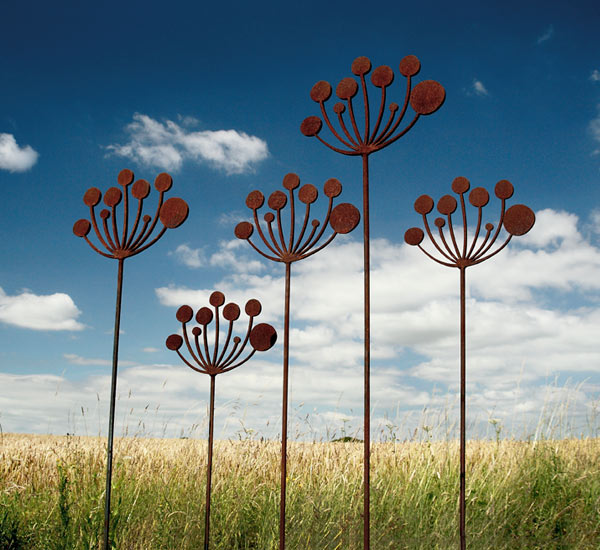 Contemporary Cow Parsley garden sculptures crafted from rusted metal