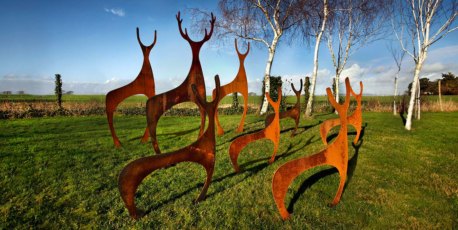 Contemporary rusted metal Deer garden sculptures created by Garden Art and Sculpture