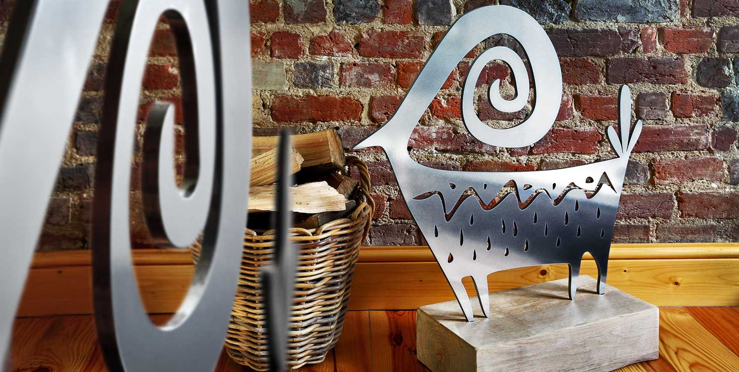 Contemporary sculpture with a polished steel finish crafted by Garden Art and Sculpture