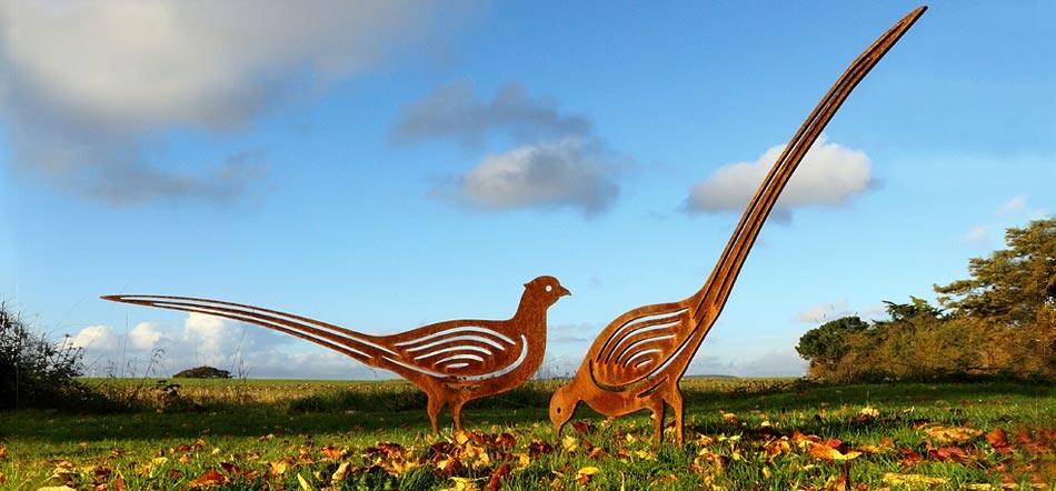 Rusted metal garden sculpture and garden art