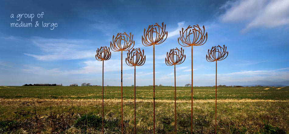 Rusted metal sculpture by garden art and sculpture
