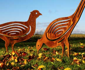 rusted metal pheasant garden sculptures and garden art