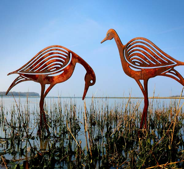 Sandpipers, a pair of rusted metal bird sculptures for garden or pond