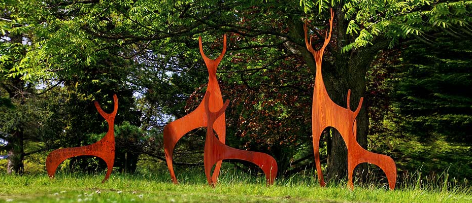 Contemporary rusted metal deer sculptures for the garden