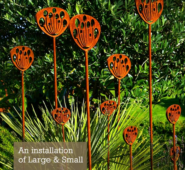 Rusted metal cow parsley garden sculptures