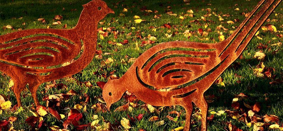 A brace of pheasant garden sculptures
