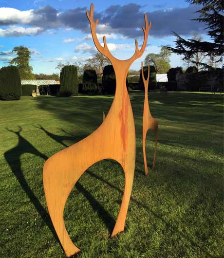 Rusted metal deer sculpture by garden art and sculpture