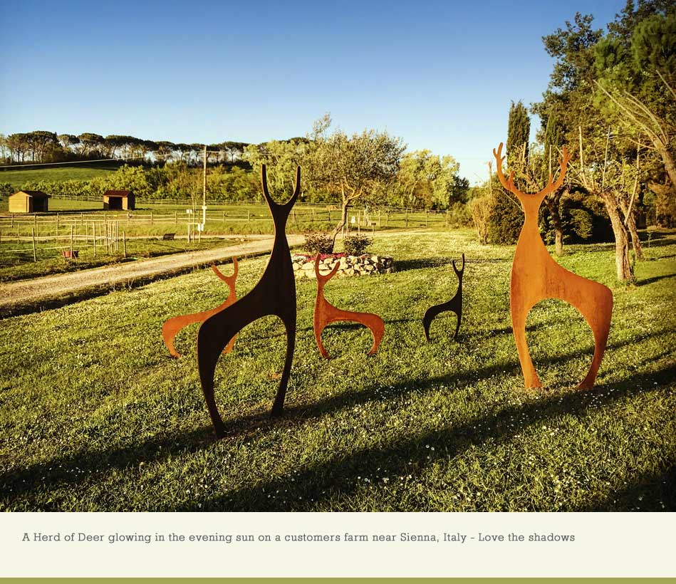 Deer sculptures made from rusted metal by garden art and sculpture