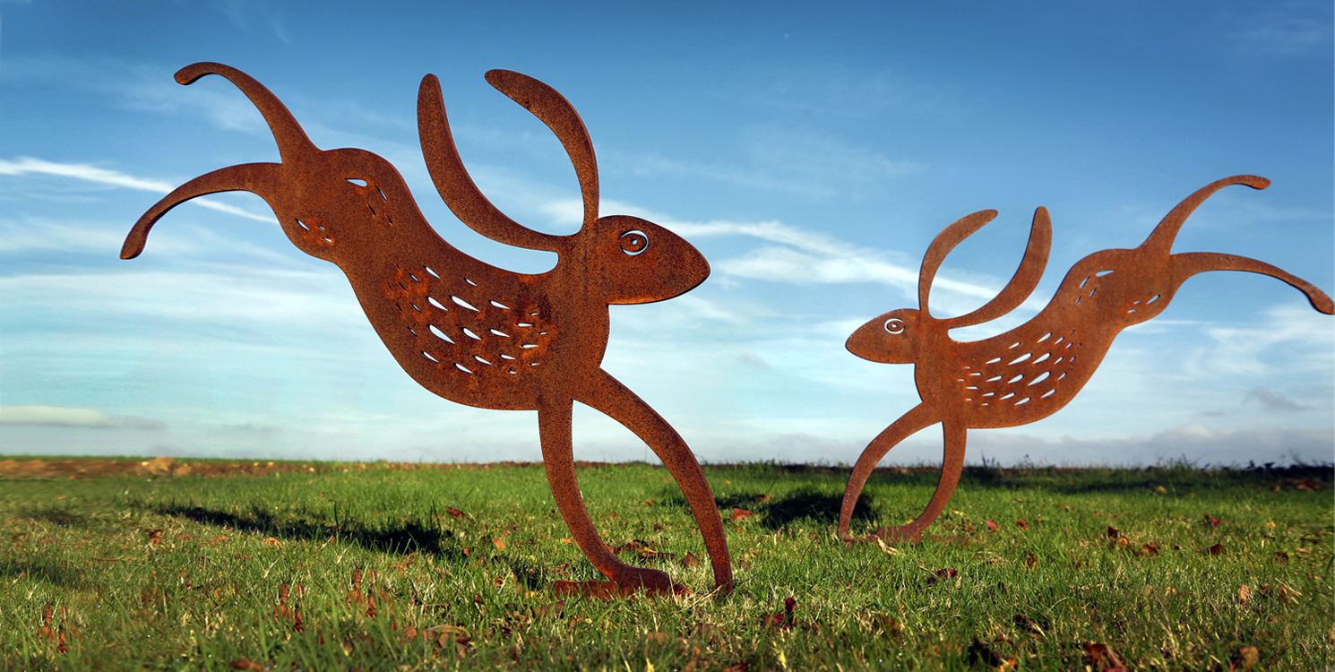 Rusted metal hare garden sculptures