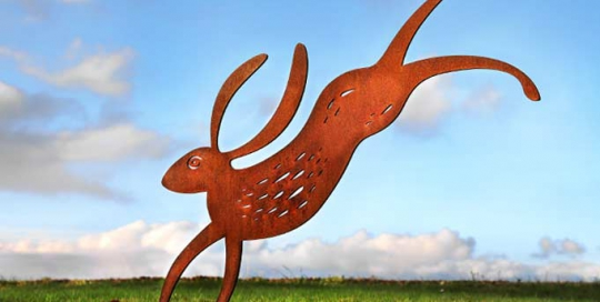 rusted metal hare garden sculpture