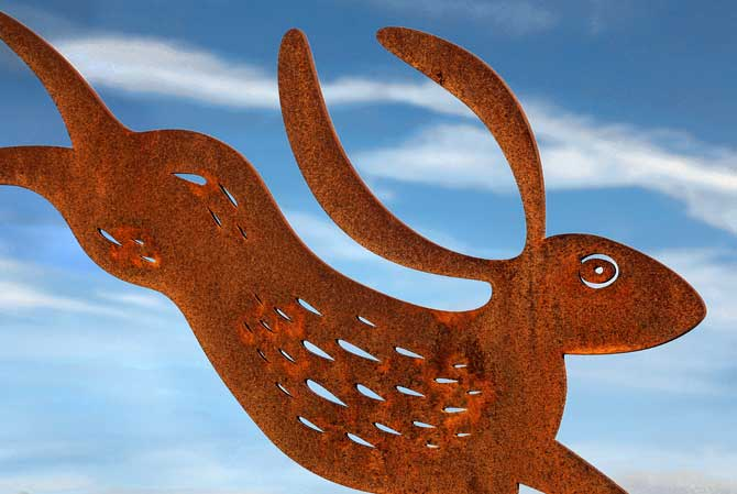 Rusted metal garden sculptures