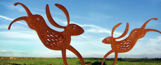 Hare garden sculpture crafted from rusted metal