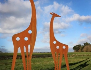contemporary rusted metal giraffe sculptures for the garden