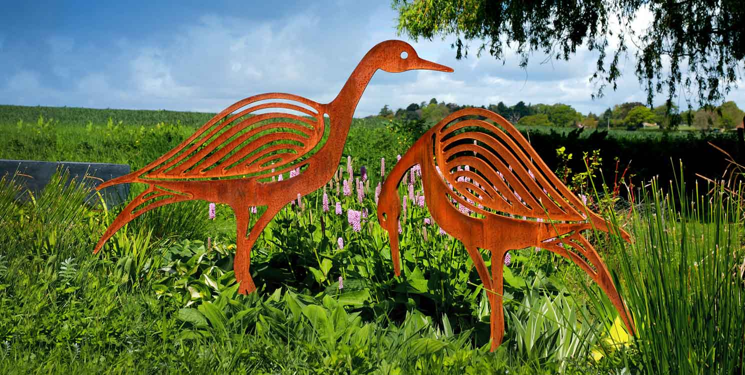 Contemporary metal bird sculptures for the garden
